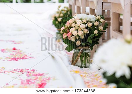 wedding ceremony decorations rose petals boquet in vase
