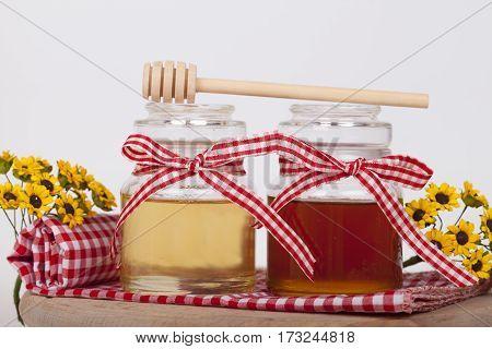 Honey In Jar On A Light Background