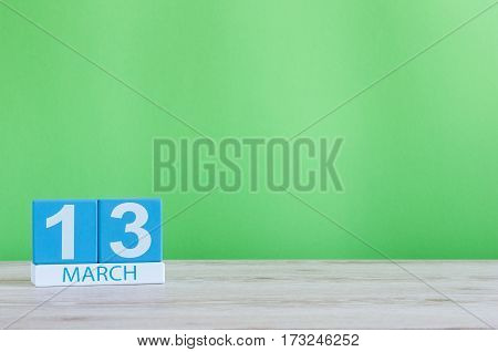 March 13th. Image of march 13 wooden color calendar on white background. Spring day, empty space for text.