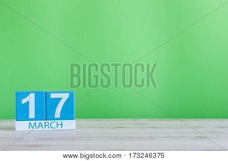 Happy St Patricks Day save the date. March 17th. Image of march 17 wooden color calendar on white background. Spring day, empty space for text.