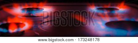 Flame gas burner on a dark background
