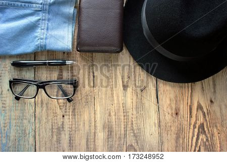 Overhead view of men's casual outfits Outfits of traveler  male Men's casual outfits on wood board background