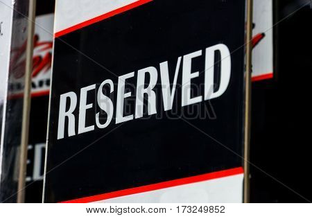 Sign reserved white letters on a dark background