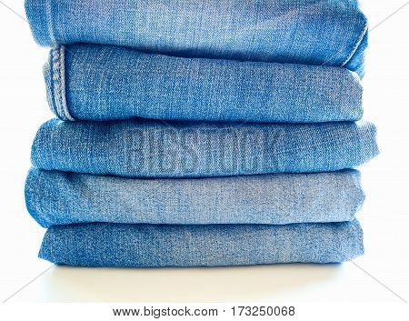 Pile of different blue jeans fabric texture