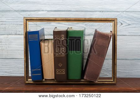 Open book hardback colorful books on wooden table. Back to school. Copy space for text. Education business concept.Picture