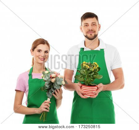 Woman with beautiful bouquet of roses and man holding house plant on white background