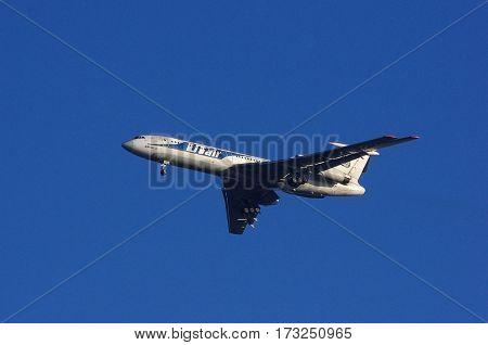VNUKOVO MOSCOW REGION RUSSIA - October 10 2010: Tupolev Tu-154M Utair airline landing in Vnukovo International Airport.