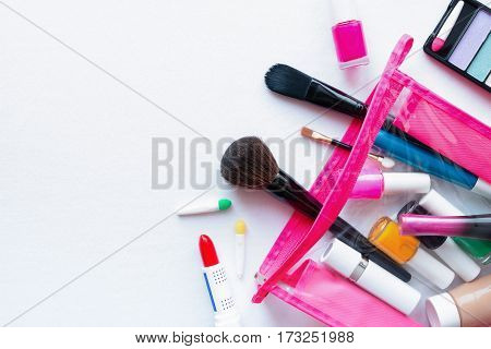 makeup bag with cosmetics and accessories on a white background