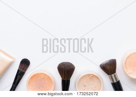 Face Powder And Brush For Makeup On A White Background With Space For Text
