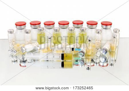 tablets and vaccines in medical bottles on a white background