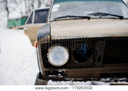 Headlights Of Old Soviet Car On Snowy Weather.