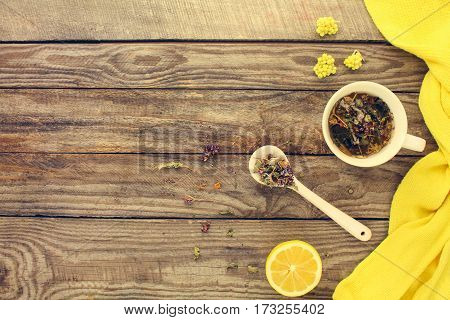 Tea with herbs, lemon, medicine. Top view. Toned image.
