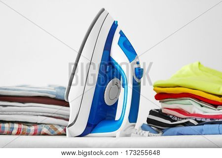 Modern iron and clean clothes on board