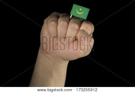 Man Hand Fist With Mauritanian Flag Isolated On Black Background