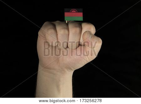 Man hand fist with Malawi flag isolated on black background poster