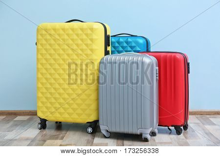 Packed travel suitcases on light background