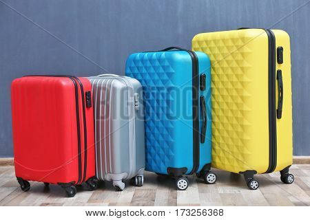 Packed travel suitcases on color background