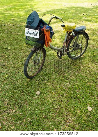 Old bicycle of garden worker on greensward
