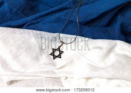 David star jewish symbol on a wooden background with book