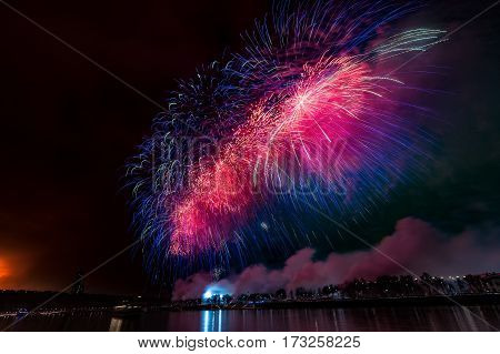 Fireworks explode glittering with dazzling results in Moscow Russia. 23 February celebration.