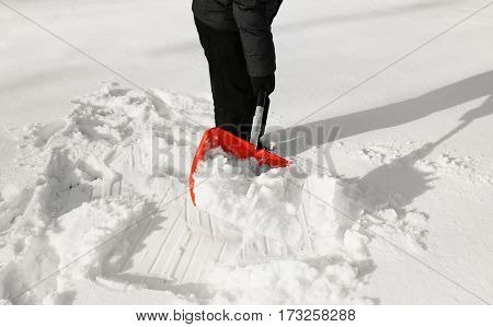 Man removing snow with snow shovel