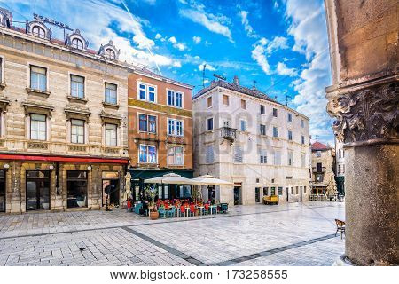 Scenic colorful architecture at marble square in old city center of town Split, european travel destination