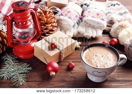 Cup of cocoa and Christmas decoration on wooden background