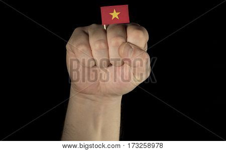 Man Hand Fist With Vietnamese Flag Isolated On Black Background