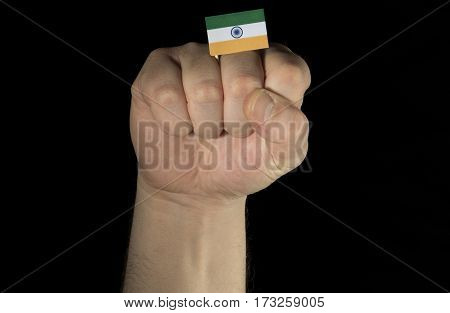 Man Hand Fist With Indian Flag Isolated On Black Background