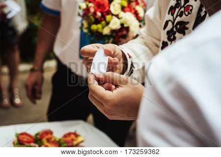 Stylish Groom Having Fun And Holding A Note, Wedding Ceremony