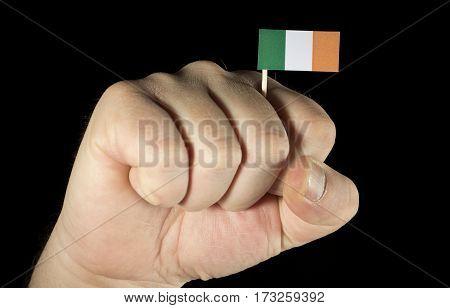 Man Hand Fist With Irish Flag Isolated On Black Background