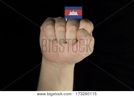Man Hand Fist With Cambodian Flag Isolated On Black Background