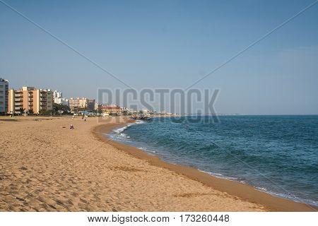 Deserted beach in the resort village of Santa Susanna. Barcelona Catalonia Spain. May 2006