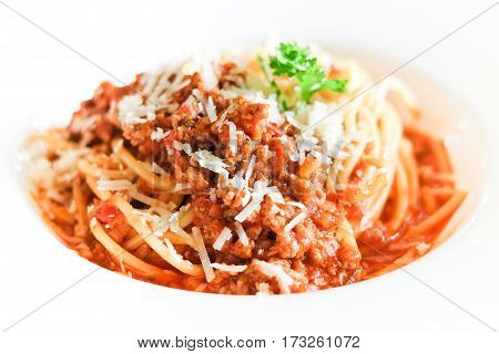 Traditional Spaghetti with minced beef tomato sauce in a white bowl