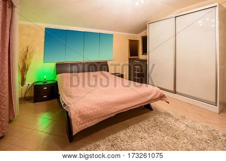 decoration and furniture in modern bedroom. The bedroom in shades of brown