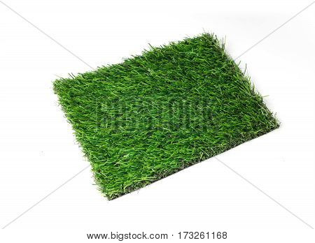 Grass mat on white background. Artificial turf tile.