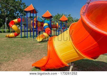 Modern children playground in park with blue sky