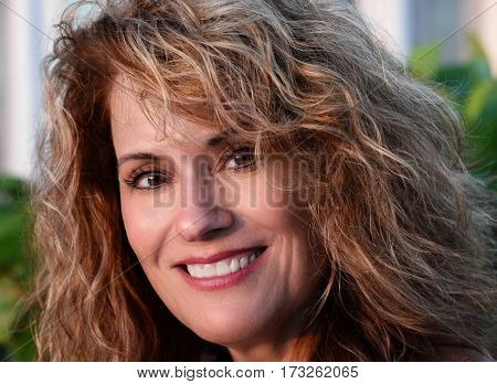 Outdoor Portrait of a Beautiful Woman Smiling at the Camera