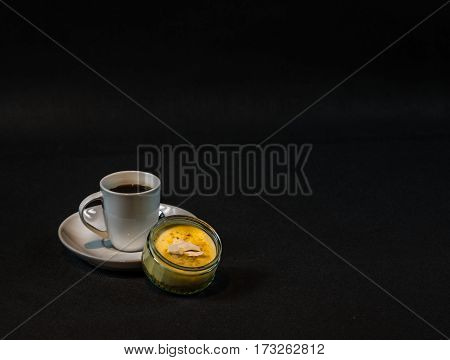 aromatic black coffee in a white cup sweet dessert creme pudding teaspoon sweet set