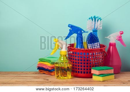 Spring cleaning concept with supplles over mint background