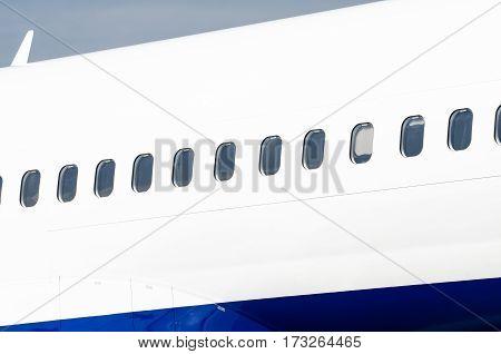 Many porthole on the big white plane
