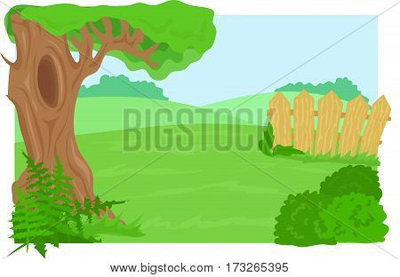 Tree with a hollow, green meadow, wooden fence