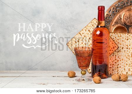 Passover holiday greeting card with wine and matzoh over rustic background