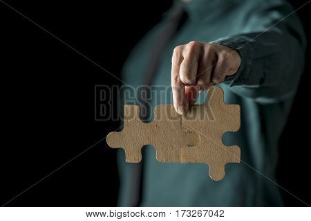 Hand With Two Puzzle Pieces