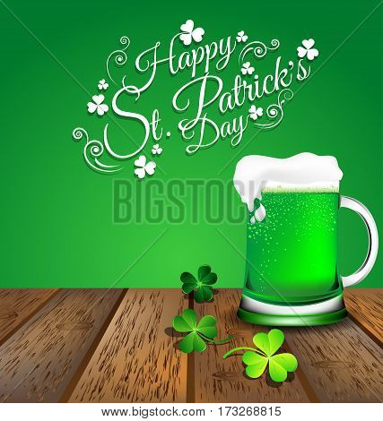 Green beer with Shamrock on wooden floor for St. Patrick's Day card