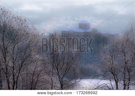 The Sanctuary of Graglia cloaked in snow and fog