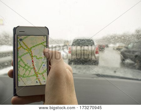 Navigation map on a mobile phone in the hand of a driver