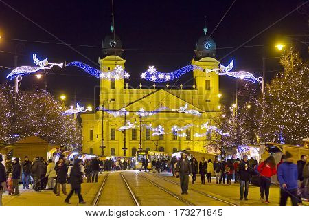 DEBRECEN, HUNGARY - DECEMBER 13, 2016: People walking at traditional Christmas Market on Kossuth square (Kossuth ter) in center of Debrecen old town