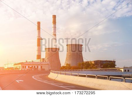 Empty road turn with thermoelectric plant on the background
