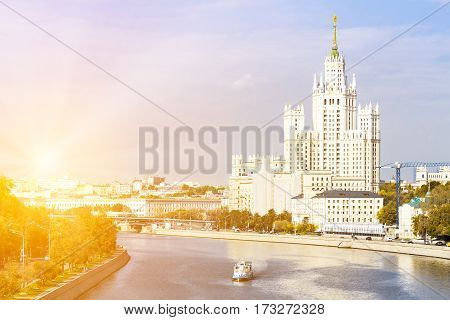Kotelnicheskaya embankment building with leisure boat on the river